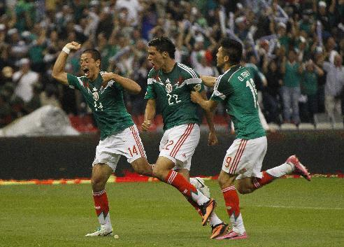 Mexico's Raul Jimenez, center, celebrates with teammates, Javier Hernandez, left, and Oribe Peralta after scoring the winning goal against Panama during a 2014 World Cup qualifying match in Mexico City, Friday, Oct. 11, 2013. (AP Photo/Eduardo Verdugo)