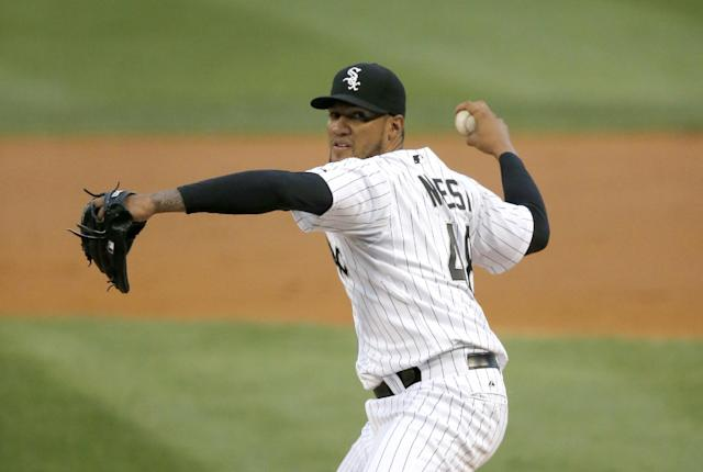 Chicago White Sox starting pitcher Hector Noesi delivers during the first inning of a baseball game against the Baltimore Orioles Wednesday, Aug. 20, 2014, in Chicago. (AP Photo/Charles Rex Arbogast)