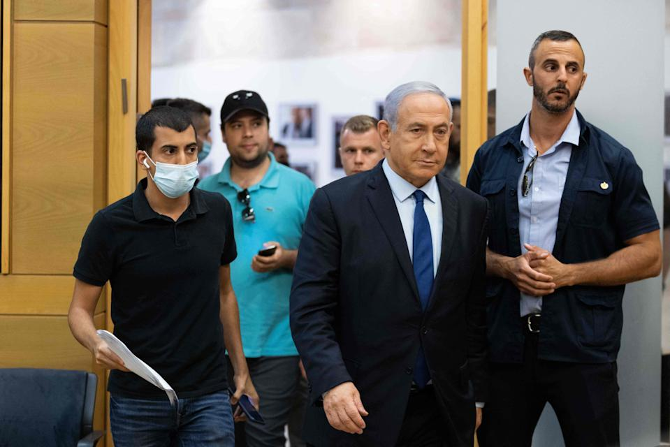 <p>Israeli Prime Minister Benjamin Netanyahu arrives at the Knesset, the Israeli Parliament, to deliver a political statement</p> (POOL/AFP via Getty Images)