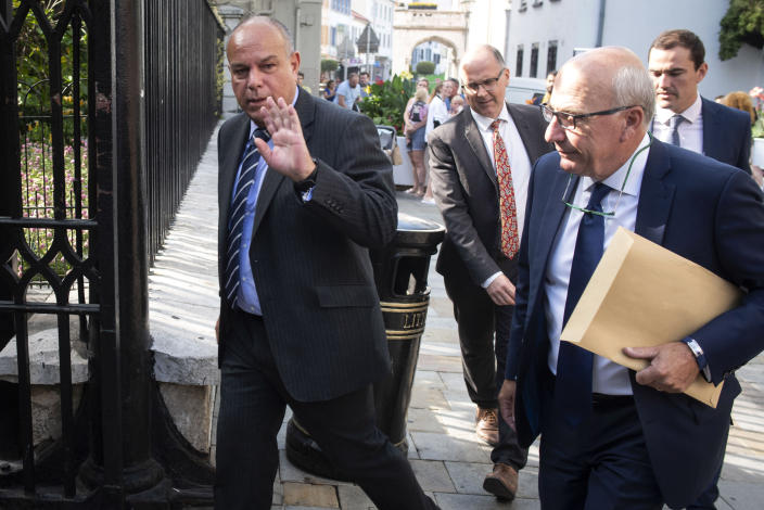 Attorney General for Gibraltar Michael Llamas, left, arrives at the court in the British territory of Gibraltar, Thursday, Aug. 15, 2019. A newspaper in Gibraltar is reporting that the United States has applied to seize an Iranian supertanker that authorities in the British overseas territory were seeking to release from detention on Thursday. (AP Photo/Marcos Moreno)