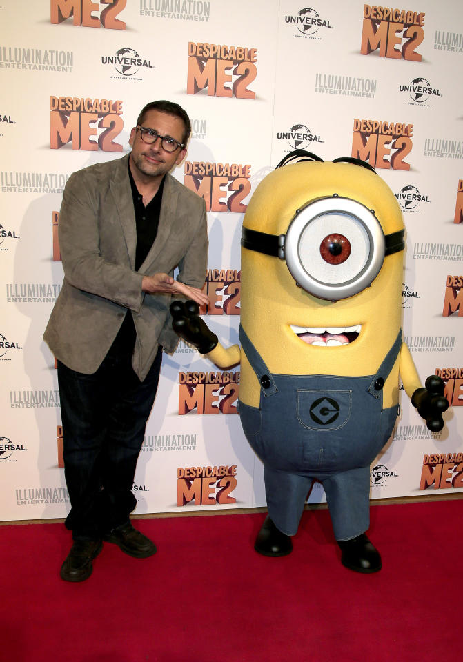 "Actor Steve Carrell poses for photos with a character from ""Despicable Me 2"" as he walks the red carpet during the film's Australian premiere in Sydney, Australia, Wednesday, June 5, 2013. (AP Photo/Rob Griffith)"
