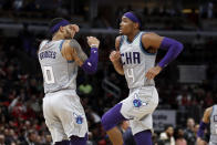 Charlotte Hornets guard Devonte' Graham, right, celebrates with forward Miles Bridges after scoring a basket during the second half of an NBA basketball game against the Chicago Bulls, Friday, Dec. 13, 2019, in Chicago. (AP Photo/Nam Y. Huh)