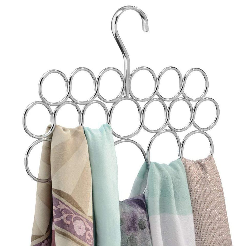 "<p>Keeping track of scarves is simple with the <a href=""https://www.popsugar.com/buy/iDesign-Axis-Metal-Loop-Scarf-Hanger-410872?p_name=iDesign%20Axis%20Metal%20Loop%20Scarf%20Hanger&retailer=amazon.com&pid=410872&price=10&evar1=casa%3Aus&evar9=45752594&evar98=https%3A%2F%2Fwww.popsugar.com%2Fhome%2Fphoto-gallery%2F45752594%2Fimage%2F45753883%2FOrganize-Scarfs&list1=amazon%2Caccessories%2Corganization%2Cstorage%20tips%2Chome%20organization&prop13=mobile&pdata=1"" class=""link rapid-noclick-resp"" rel=""nofollow noopener"" target=""_blank"" data-ylk=""slk:iDesign Axis Metal Loop Scarf Hanger"">iDesign Axis Metal Loop Scarf Hanger</a> ($10). It features 18 loops, so all your winter scarves (and even beach cover-ups) have a home. </p>"