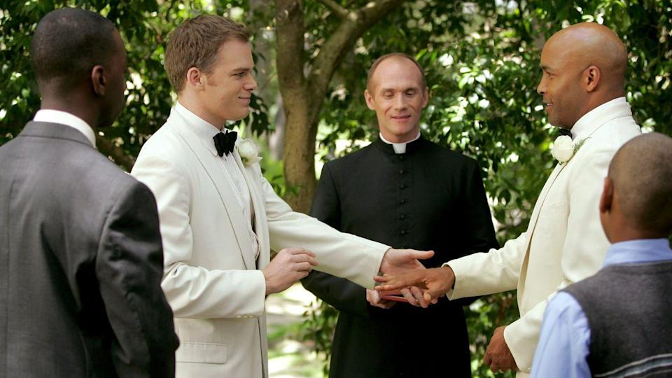 <p>One of (if not) the first same-sex weddings was featured on HBO's <em>Six Feet Under, </em>in the series finale of the show. The show was also one of the first to showcase a gay male lead, but the character (played by Michael C. Hall) doesn't get his happy ending until a dream sequence at the end of the show, which is intended to flash forward into the future. </p><p>While almost all same-sex weddings on television until this point were small civil unions, commitment ceremonies, and the like, David's wedding to Keith (played by Mathew St. Patrick) on <em>Six Feet Under</em> was iconic for many reasons—from it's formality to the two being married by a religious officiant.</p>