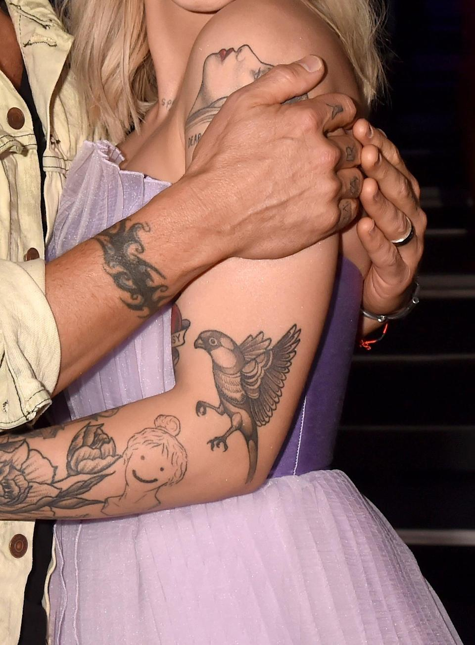 <p>During that same summer month in 2018, Michaels added this bird in flight on her left arm, just above her elbow. She's never talked about its exact meaning. </p>