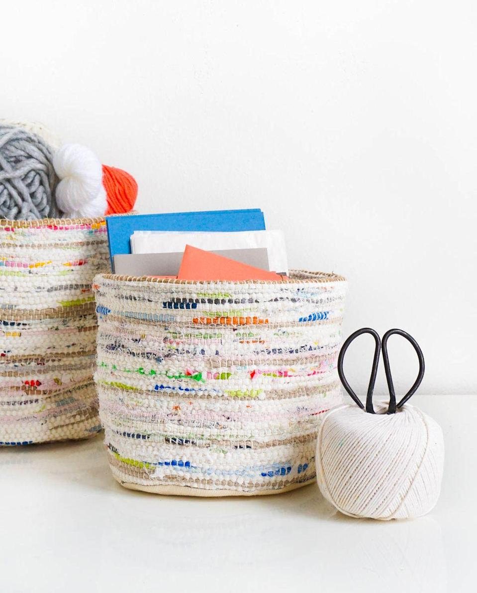 <p>Keep your threads and larger supplies that don't fit in a drawer tucked away in extra storage baskets and bins. Aside from helping you stay organized, they're a great way to introduce a little more color to the room. </p>