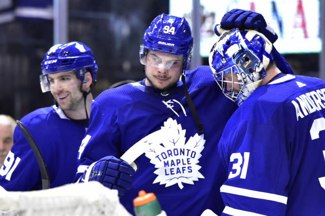 Toronto Maple Leafs goaltender Frederik Andersen (31) celebrates with John Tavares (91) and Auston Matthews (34) after the Maple Leafs defeated the New York Rangers in an NHL hockey game Saturday, Dec. 22, 2018, in Toronto. (Frank Gunn/The Canadian Press via AP)