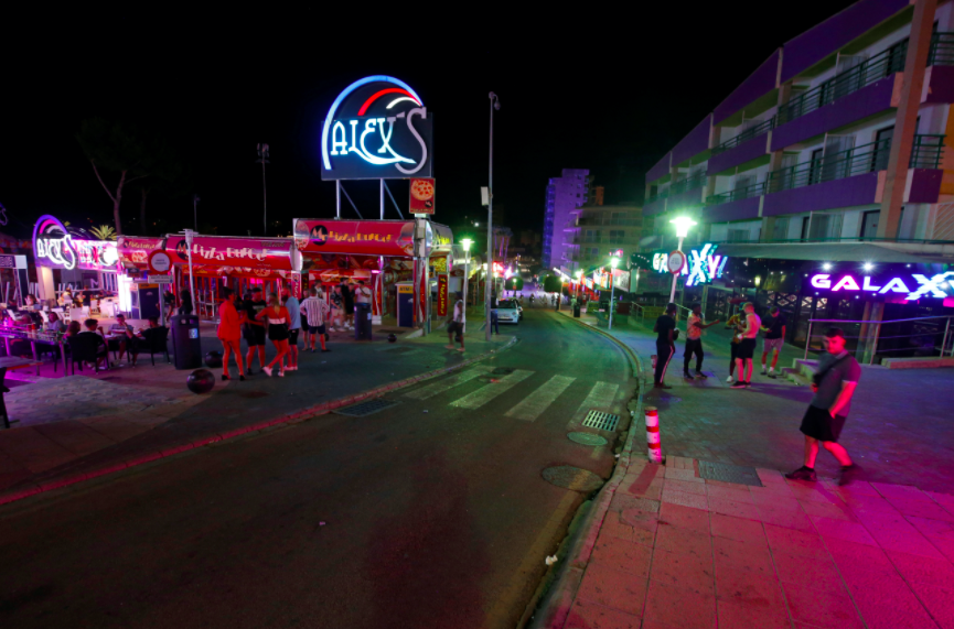 Tourists on the party strip were filmed appearing to flout social distancing rules. (Reuters)