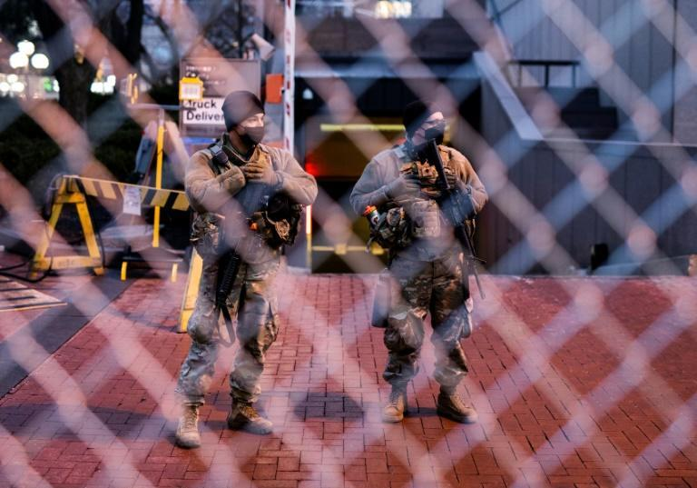 Members of the Minnesota National Guard stand guard outside the Hennepin County Government Center where the George Floyd murder trial is taking place