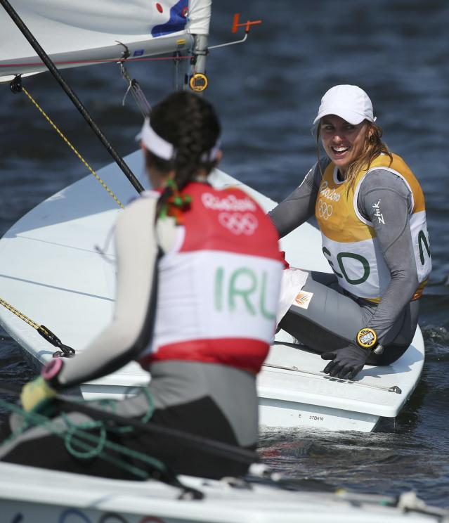 2016 Rio Olympics - Sailing - Final - Women's One Person Dinghy - Laser Radial - Medal Race - Marina de Gloria - Rio de Janeiro, Brazil - 16/08/2016. Marit Bouwmeester (NED) of Netherlands celebrates gold medal next to silver medalist Annalise Murphy (IRL) of Ireland. REUTERS/Benoit Tessier FOR EDITORIAL USE ONLY. NOT FOR SALE FOR MARKETING OR ADVERTISING CAMPAIGNS.