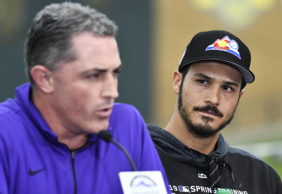 SCOTTSDALE, AZ - FEBRUARY 27: Colorado Rockies third baseman Nolan Arenado (28) listens to GM Jeff Bridich during his press conference at Salt River Fields February 27, 2019. The Colorado Rockies and Arenado signed a 8-year, $260 million dollar deal, largest in franchise history, with a opt-out clause after three years. (Photo by Andy Cross/MediaNews Group/The Denver Post via Getty Images)