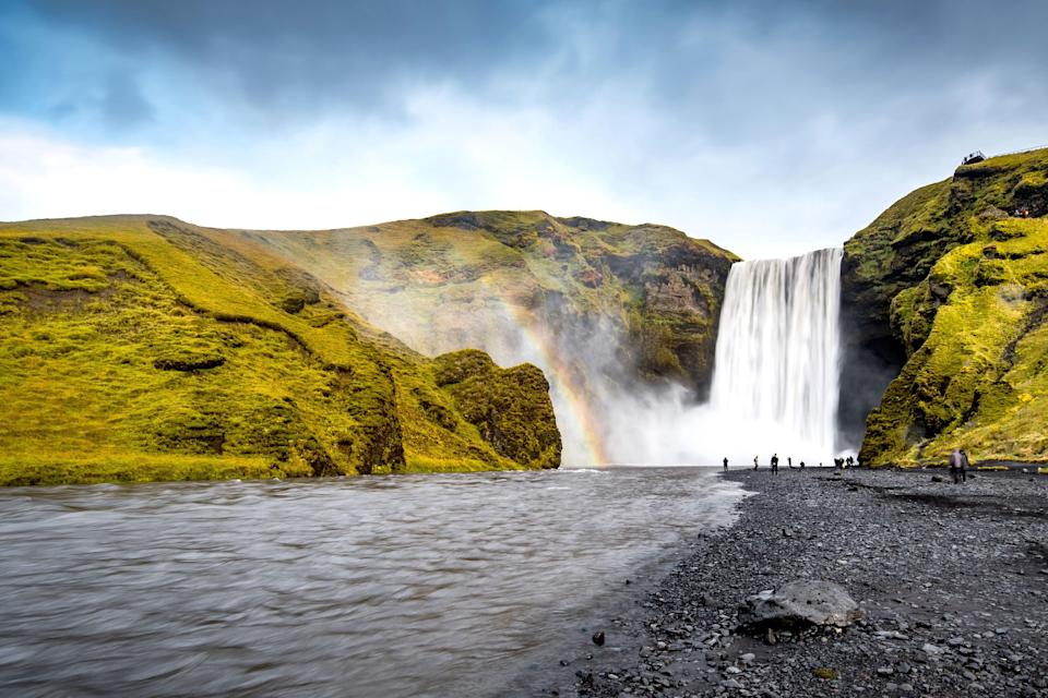 An easy stop off Route 1 (aka the Ring Road), Skógafoss is one of the most beautiful places in Iceland—and in a land of so many waterfalls, that's definitely saying something. The 197-foot cascade crashes onto black sand, and you can walk right up to the bottom if you're willing to get drenched. Worth it for the double rainbow viewings, we say.
