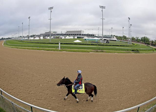 Exercise rider Faustino Aguilar takes Kentucky Derby hopeful Medal Count for a morning workout at Churchill Downs Wednesday, April 30, 2014, in Louisville, Ky. (AP Photo/Charlie Riedel)