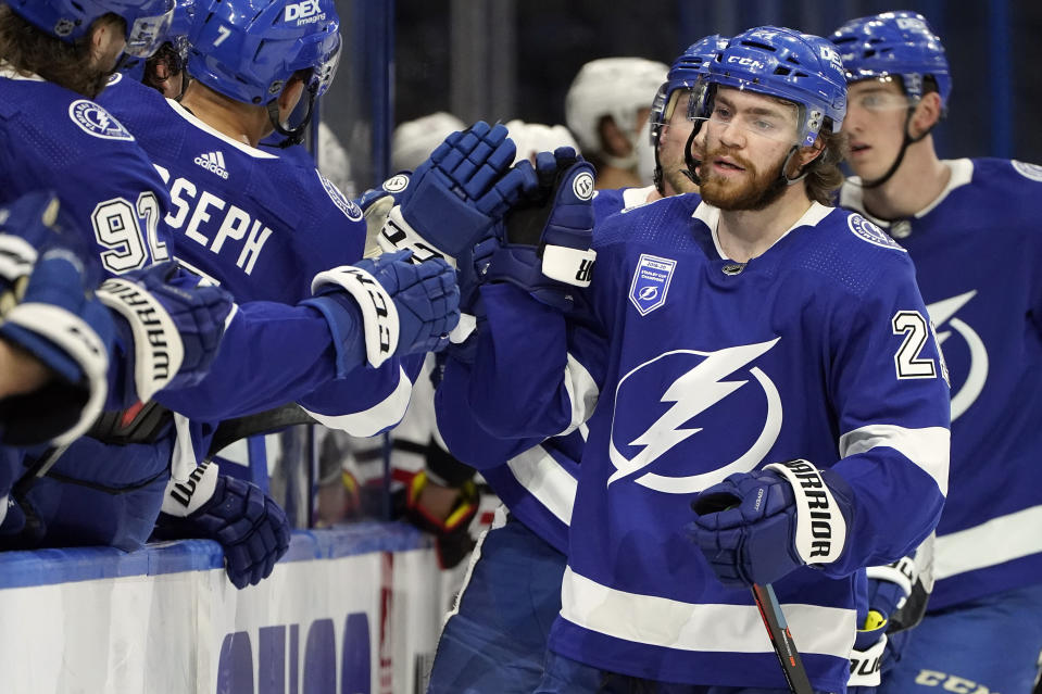 Tampa Bay Lightning center Brayden Point (21) celebrates with the bench after his goal against the Chicago Blackhawks during the third period of an NHL hockey game Wednesday, Jan. 13, 2021, in Tampa, Fla. (AP Photo/Chris O'Meara)