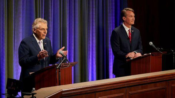 PHOTO: Democratic gubernatorial candidate and former governor Terry McAuliffe, left, gestures as his Republican challenger, Glenn Youngkin, looks on during a debate at the Appalachian School of Law in Grundy, Va., Sept. 16, 2021. (Steve Helber/AP)