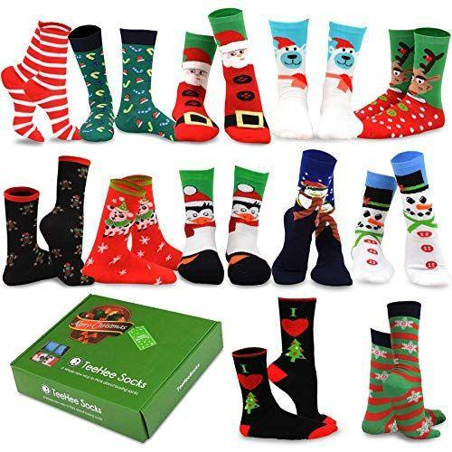 """<p><strong>TeeHee Socks</strong></p><p>amazon.com</p><p><strong>$21.99</strong></p><p><a href=""""https://www.amazon.com/dp/B01N9VU86S?tag=syn-yahoo-20&ascsubtag=%5Bartid%7C10055.g.29429168%5Bsrc%7Cyahoo-us"""" rel=""""nofollow noopener"""" target=""""_blank"""" data-ylk=""""slk:Shop Now"""" class=""""link rapid-noclick-resp"""">Shop Now</a></p><p>Wear a different pair of holiday socks every day for almost two weeks with this Advent sock calendar. Some of them are more generically winter-centric, so you can still rock them into January and February, too. </p>"""