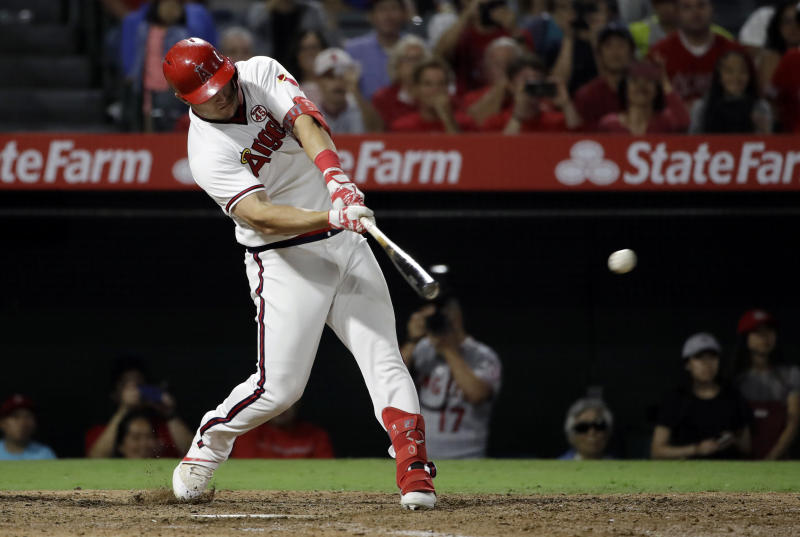Los Angeles Angels' Mike Trout drives in two runs with a single against the Chicago White Sox during the seventh inning of a baseball game Saturday, Aug. 17, 2019, in Anaheim, Calif. (AP Photo/Marcio Jose Sanchez)