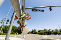 Flowers hang at a Danville, Calif., intersection where, in March, Danville police officer Andrew Hall shot and killed Tyrell Wilson as he held a knife on Monday, May 3, 2021. Wilson was shot and killed by Hall just weeks before prosecutors charged the same officer with manslaughter and assault in the fatal shooting of an unarmed Filipino man more than two years earlier. (AP Photo/Noah Berger)