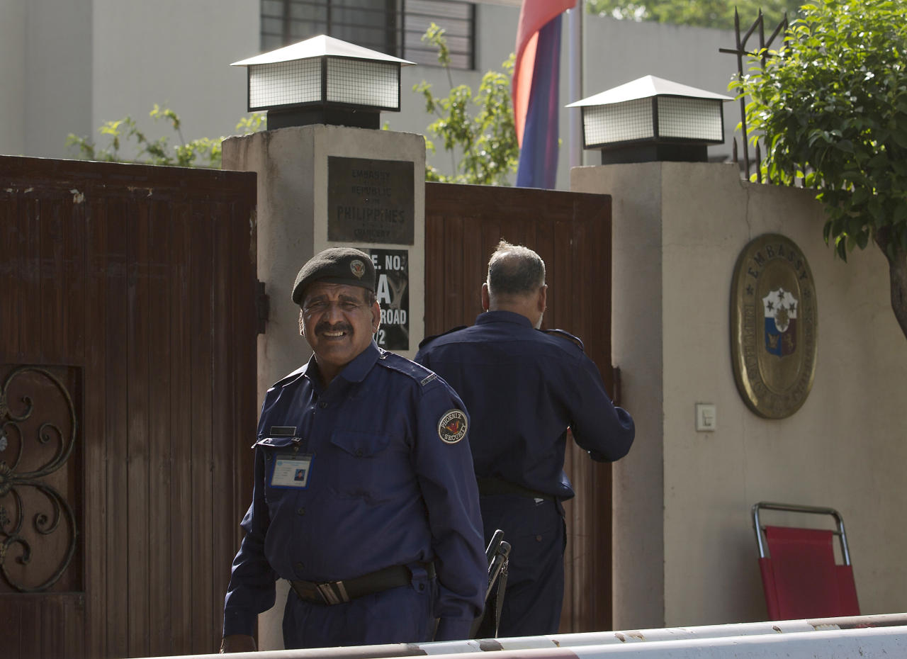 Pakistani guards stand alert outside the embassy of the Philippines where a national flag is at half-mast mourning the reported death of Ambassador Domingo Lucenario Jr. in Islamabad, Pakistan, Friday, May 8, 2015. The ambassadors to Pakistan from the Philippines and Norway and the wives of the ambassadors from Malaysia and Indonesia were killed Friday when a Pakistani army helicopter carrying foreign dignitaries made a crash landing in the country's north, the military said. (AP Photo/B.K. Bangash)
