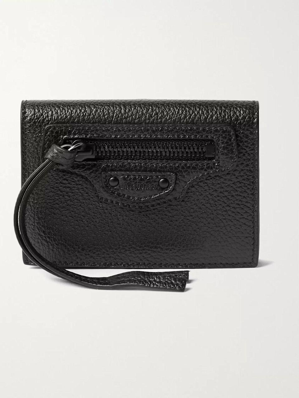 """<p><strong>Balenciaga</strong></p><p>mrporter.com</p><p><strong>$450.00</strong></p><p><a href=""""https://go.redirectingat.com?id=74968X1596630&url=https%3A%2F%2Fwww.mrporter.com%2Fen-us%2Fmens%2Fproduct%2Fbalenciaga%2Faccessories%2Fzip-wallets%2Ffull-grain-leather-coin-wallet%2F19971654707377223&sref=https%3A%2F%2Fwww.esquire.com%2Fstyle%2Fmens-accessories%2Fg35924710%2Fmens-luxury-wallets%2F"""" rel=""""nofollow noopener"""" target=""""_blank"""" data-ylk=""""slk:Shop Now"""" class=""""link rapid-noclick-resp"""">Shop Now</a></p><p>Who knew a simple zipper pull could look so damn cool? </p>"""