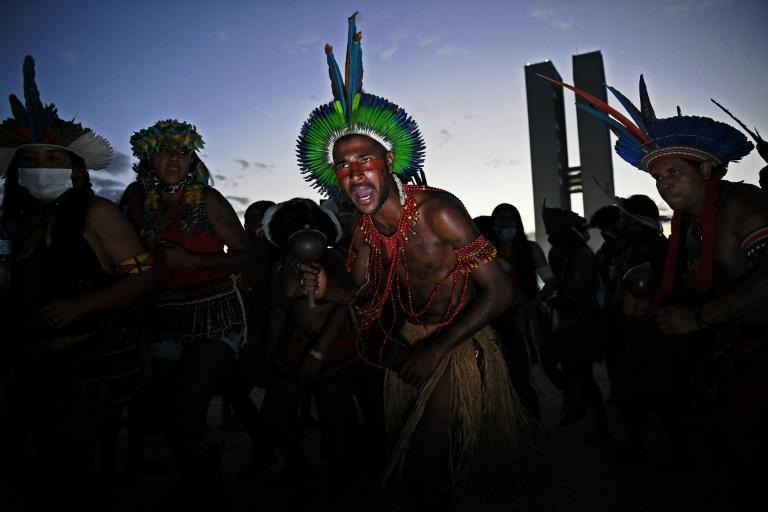 Indigenous men are seen during a protest outside the Supreme Court building in Brasilia, on August 24, 2021