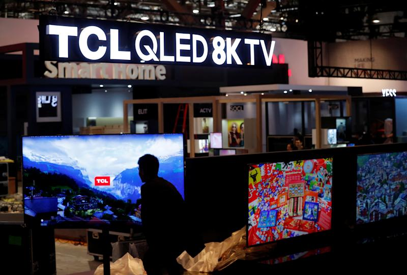A display of QLED 8K televisions is shown at the TCL booth in the Las Vegas Convention Center as workers prepare for 2019 CES in Las Vegas, Nevada, U.S. January 6, 2019. REUTERS/Steve Marcus
