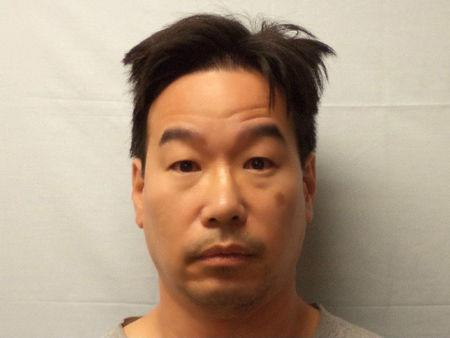 Former New England Compounding Center supervisory pharmacist Glenn Chin is pictured in Canton, Massachusetts, U.S. in this undated handout booking photo obtained by Reuters September 19, 2017.  Canton Police Department/Handout via REUTERS
