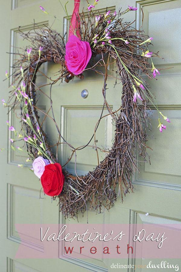 """<p>Highlight this heart-shaped grapevine wreath with silk florals and homemade felt roses and you'll have a door hanger perfect for the season of romance.</p><p><strong>Get the tutorial at <a href=""""https://www.delineateyourdwelling.com/valentines-day-wreath/"""" rel=""""nofollow noopener"""" target=""""_blank"""" data-ylk=""""slk:Delineate Your Dwelling"""" class=""""link rapid-noclick-resp"""">Delineate Your Dwelling</a>.</strong></p><p><a class=""""link rapid-noclick-resp"""" href=""""https://www.amazon.com/pink-felt/s?k=pink+felt&tag=syn-yahoo-20&ascsubtag=%5Bartid%7C10050.g.35057743%5Bsrc%7Cyahoo-us"""" rel=""""nofollow noopener"""" target=""""_blank"""" data-ylk=""""slk:SHOP PINK FELT"""">SHOP PINK FELT</a><br></p>"""