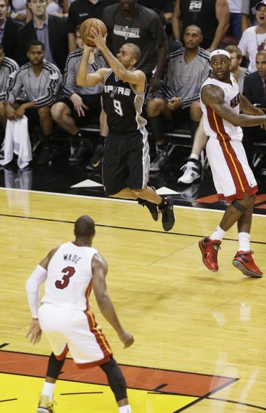 San Antonio Spurs point guard Tony Parker (9) makes the final shot of the game against the Miami Heat during the second half of Game 1 of the NBA Finals basketball game, Thursday, June 6, 2013 in Miami. The Spurs defeated the Heat 92-88. (AP Photo/Wilfredo Lee)