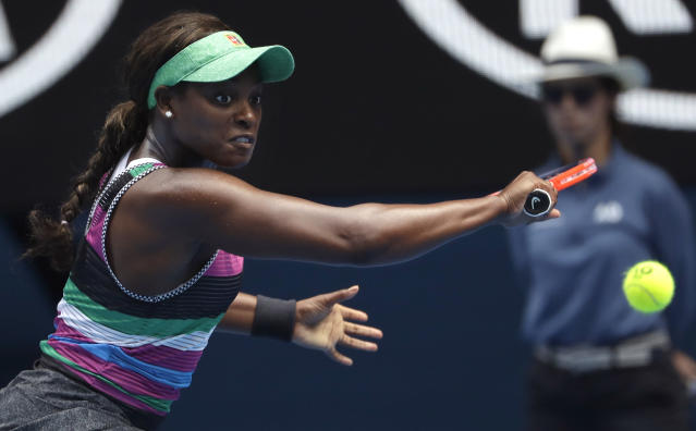 United States' Sloane Stephens makes a backhand return to Hungary's Timea Babos during their second round match at the Australian Open tennis championships in Melbourne, Australia, Wednesday, Jan. 16, 2019. (AP Photo/Mark Schiefelbein)