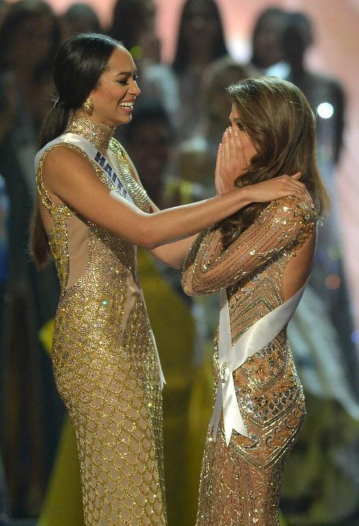 <p>Miss Universe candidate Iris Mittenaere (R) of France reacts after being named Miss Universe over fellow candidate, first runner-up Raquel Pellisier of Haiti (L), in the Miss Universe pageant at the Mall of Asia Arena in Manila on January 30, 2017. France was crowed Miss Universe on January 30 in a glitzy spectacle free of last year's dramatic mix-up but with a dash of political controversy as finalists touched on migration and other hot-button global issues. / AFP PHOTO / TED ALJIBE </p>