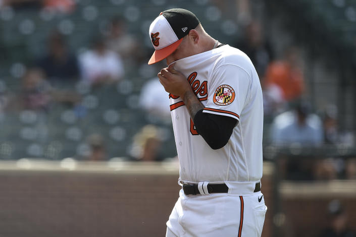 Baltimore Orioles pitcher Tyler Wells leaves the pitchers mound after giving up a three-run home run to the Chicago White Sox In the 10th inning of a baseball game, July 11, 2021 in Baltimore.(AP Photo/Gail Burton)