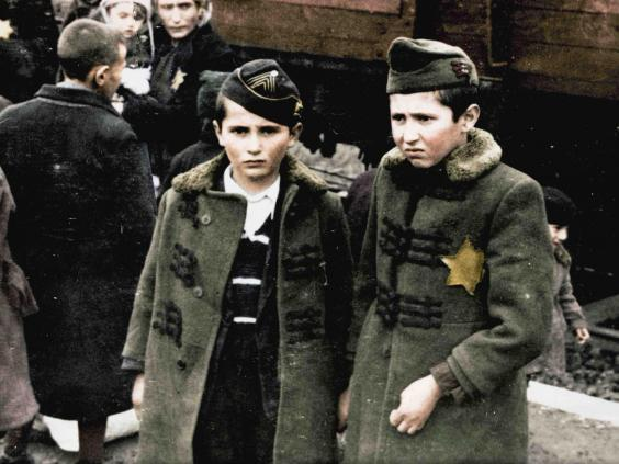 Two boys wait after arriving at Auschwitz in cattle cars (The Auschwitz Album — Serge Klarsfeld/Lily Jacob-Zelmanovic Meier)