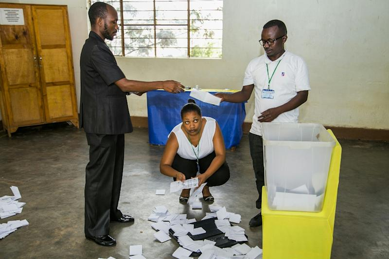 Election agents count ballot papers at a polling station in the capital Kigali on December 18, 2015 (AFP Photo/Cyril Ndegeya)