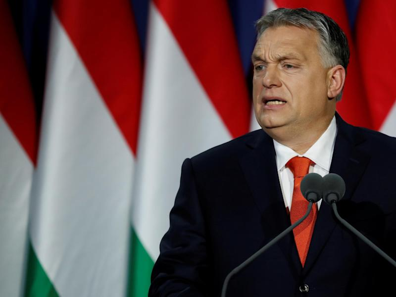 "Hungarian Prime Minister Viktor Orban delivers his annual state of the nation speech in Budapest. Slogan reads ""For us, Hungary first!"": REUTERS/Bernadett Szabo"