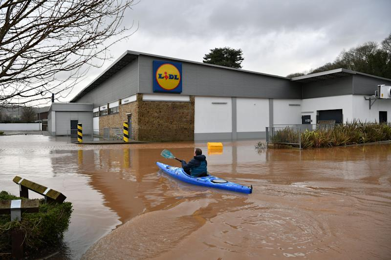 A canoeist makes their way towards Lidl in Monmouth in the aftermath of Storm Dennis (Photo: PA)