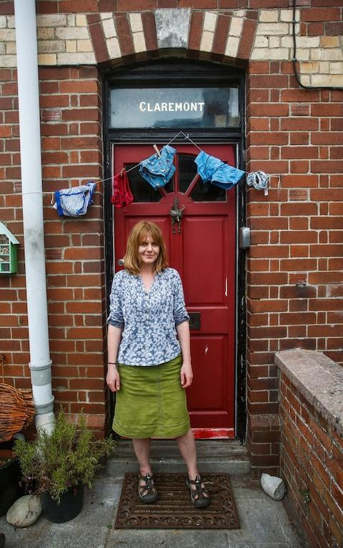 Claire Mountjoy outside her house in Colyton, Devon - Credit: SWNS.com