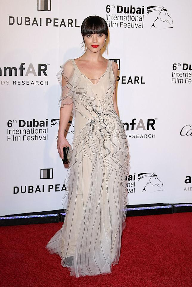 "Also in Dubai was actress Christina Ricci, who attended the 3rd Annual amfAR Cinema Against AIDS event. The former child star was all grown-up in a flowing Marc Jacobs gown and face-framing dark bangs. Gareth Cattermole/<a href=""http://www.gettyimages.com/"" target=""new"">GettyImages.com</a> - December 10, 2009"
