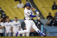 Los Angeles Dodgers' Austin Barnes connects for a three-run home run during the ninth inning of a baseball game against the Los Angeles Dodgers Friday, May 28, 2021, in Los Angeles. (AP Photo/Marcio Jose Sanchez)