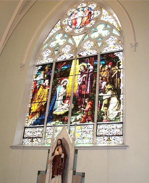 """In this Jan. 12, 2014 photo, a stained glass window inside 114-year-old Our Lady of Perpetual Help Church in Buffalo, N.Y., is shown during a """"Mass Mob."""" Borrowed from the idea of flash mobs, Mass Mobs encourages crowds to attend Mass at a specified church on a certain day to fill pews, lift spirits and help financially some of the city's most historic but often sparsely attended churches. (AP Photo/Carolyn Thompson)"""
