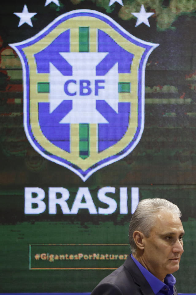 Brazil's soccer team coach Tite arrives for a news conference to announce his list of players for the 2018 Soccer World Cup in Russia, in Rio de Janeiro, Brazil, Monday, May 14, 2018. (AP Photo/Leo Correa)
