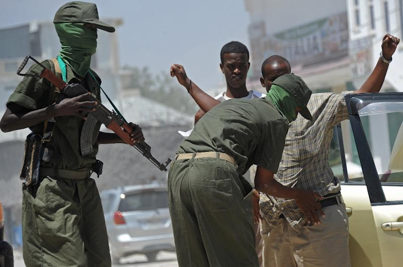 Somalia federal government soldiers conduct random check of public transport vehicles during a patrol on the streets of Mogadishu on February 18, 2015 (AFP Photo/Mohamed Abdiwahab)
