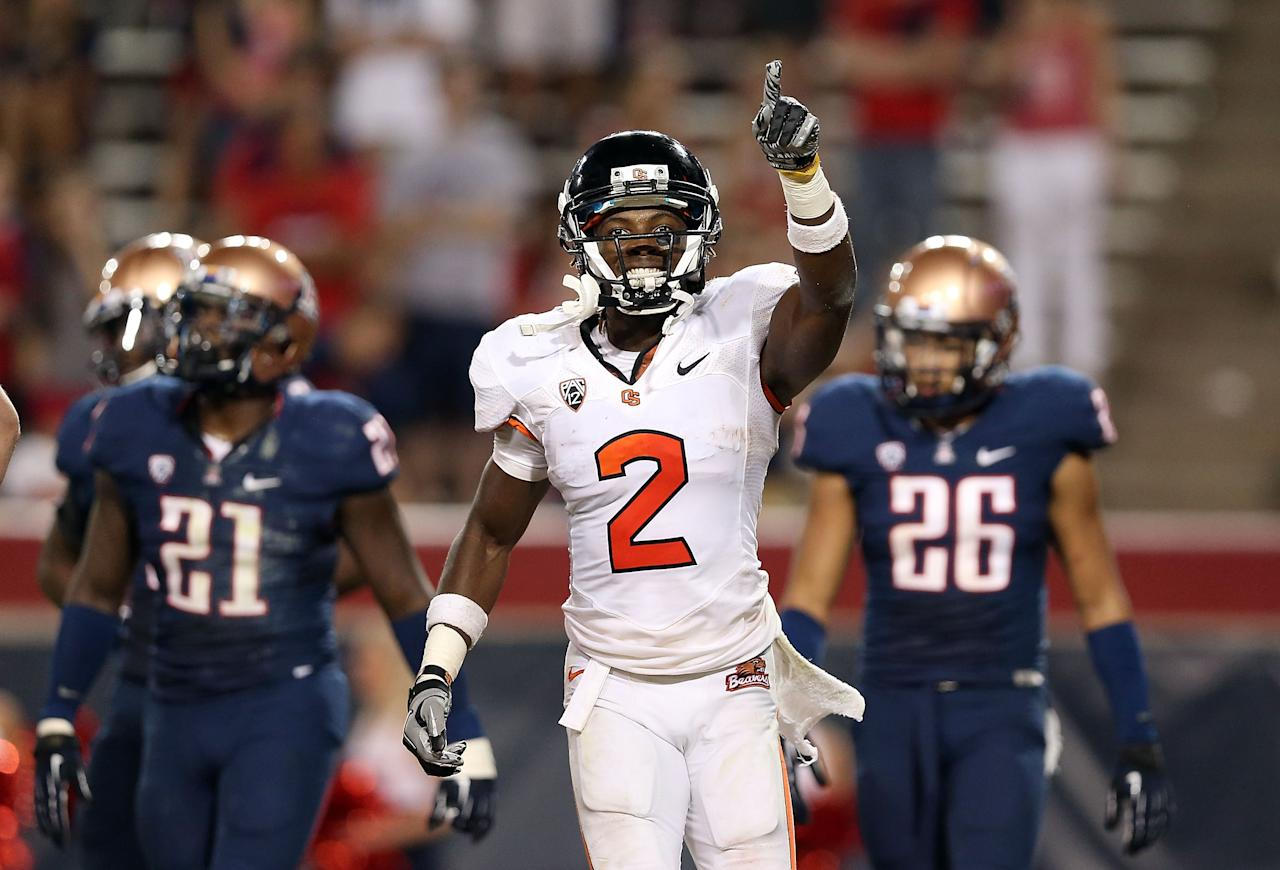 TUCSON, AZ - SEPTEMBER 29:  Wide receiver Markus Wheaton #2 of the Oregon State Beavers celebrates after scoring on a 20 yard touchdown reception against the Arizona Wildcats during the fourth quarter of the college football game at Arizona Stadium on September 29, 2012 in Tucson, Arizona.  The Beavers defeated the Wildcats 38-35. (Photo by Christian Petersen/Getty Images)