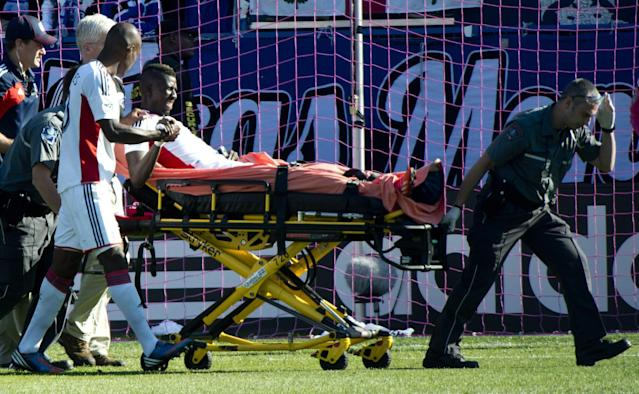 New England Revolution's Saer Sene is taken out on a stretcher during first half of an MLS soccer match against the Montreal Impact on Saturday, Oct. 12, 2013 in Montreal. (AP Photo/The Canadian Press, Paul Chiasson)