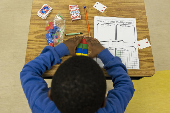 A student uses tiles while working on a multiplication problem at Ida Green Elementary. (Brad Vest / for NBC News)