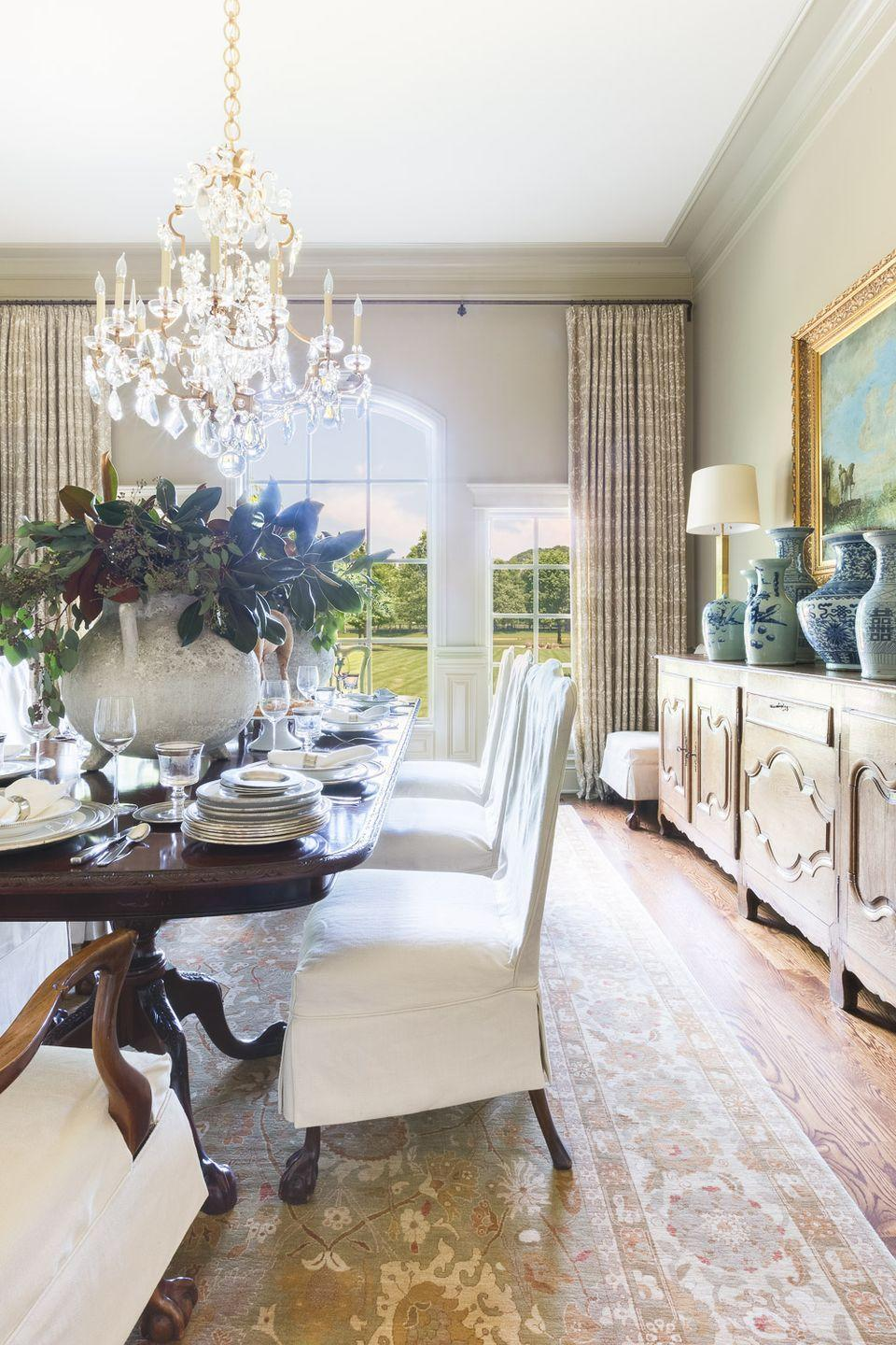 """<p>""""Simple changes like placing casual (yet pretty!) slipcovers over the English antique chippendale chairs change the feel of the dining room,"""" says Robin Rains of <a href=""""https://robinrains.com/"""" rel=""""nofollow noopener"""" target=""""_blank"""" data-ylk=""""slk:Robin Rains Interior Design"""" class=""""link rapid-noclick-resp"""">Robin Rains Interior Design</a>. </p>"""
