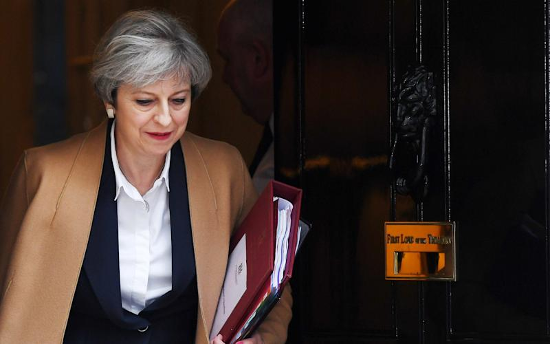 Theresa May leaves Downing Street to deliver her Article 50 statement to Parliament - EPA