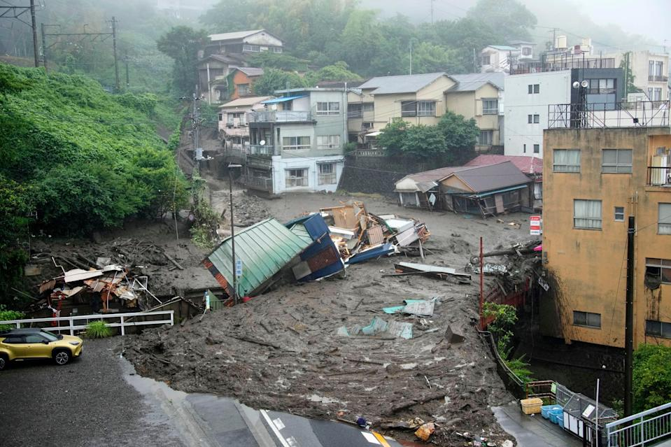 Houses are damaged by mudslide following heavy rain at Izusan district in Atami, west of Tokyo (AP)