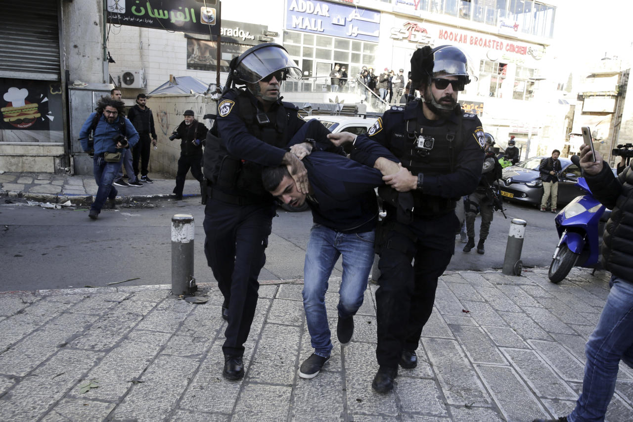 <p>Israel police arrest a Palestinian during a protest against President Donald Trump's decision to recognize Jerusalem as the capital of Israel in Jerusalem, Saturday, Dec. 9, 2017.(Photo: Mahmoud Illean/AP) </p>