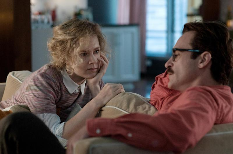 """This image released by Warner Bros. Pictures shows Amy Adams, left, and Joaquin Phoenix in a scene from """"Her."""" (AP Photo/Warner Bros. Pictures, Merrick Morton)"""